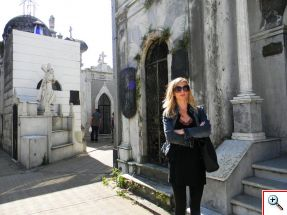 Julie is dwarfed by the mausoleums