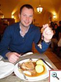 Nick eating our pork and potato dish